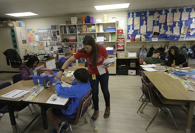 Chabot Elementary School fourth grade teacher Laura Shield talks with a stude...