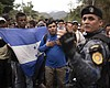 Honduran migrants walking in a group stop befor...