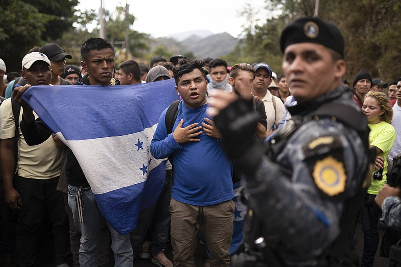 Honduran migrants walking in a group stop before Guatemalan police near Agua ...