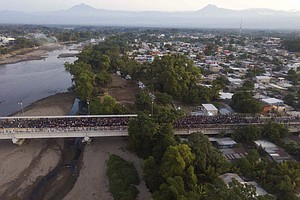 Photo for Migrants Ford River From Guatemala To Mexico