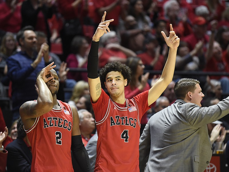San Diego State guard Adam Seiko (2) and guard Trey Pulliam (4) celebrate dur...