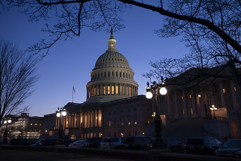 Night falls on the Capitol in Washington, Wednesday evening, Jan. 22, 2020, d...
