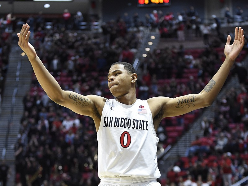 San Diego State forward Keshad Johnson (0) celebrates after the team defeated...