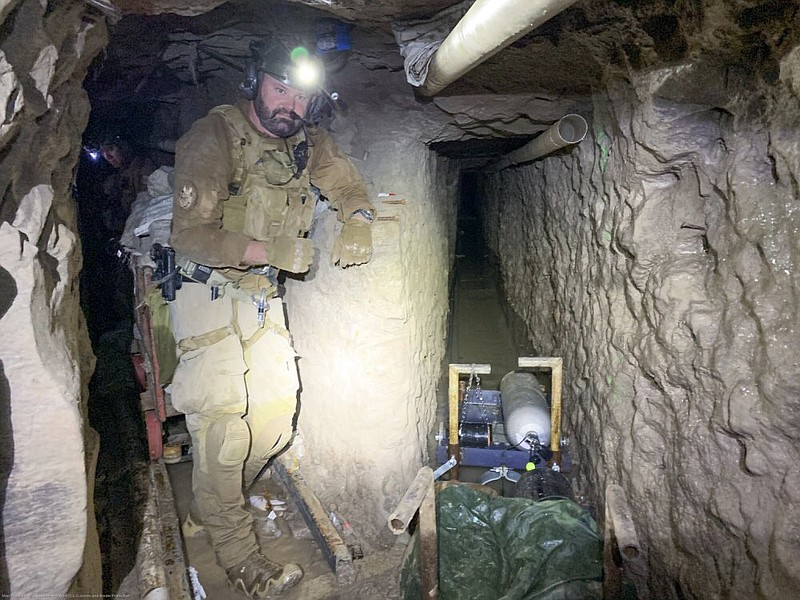 A tunnel entry team agent stands by for security Nov. 13, 2019, at a tunnel s...