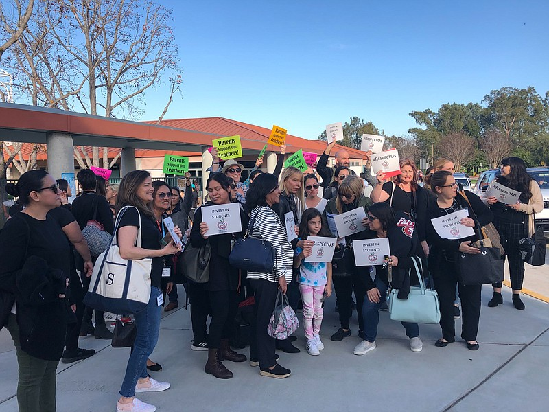 Teachers and parents demonstrate outside Clear View Elementary, protesting a ...