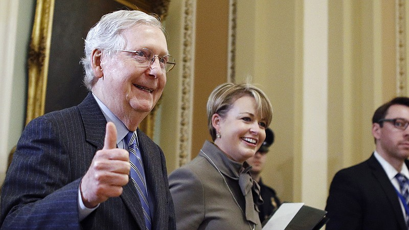 Senate Majority Leader Mitch McConnell, R-Ky., gives a thumbs up as he leaves...