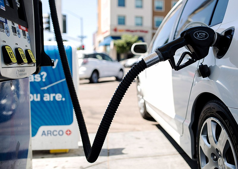 A car is shown at a gas station near the San Diego State University campus on...
