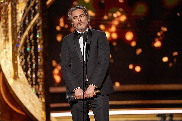 Joaquin Phoenix accepts the Oscar® for Actor In A Leading...