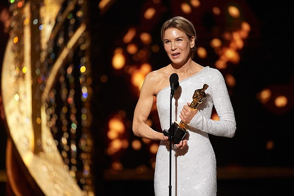 Renée Zellweger accepts the Oscar® for Actress In A Leadi...