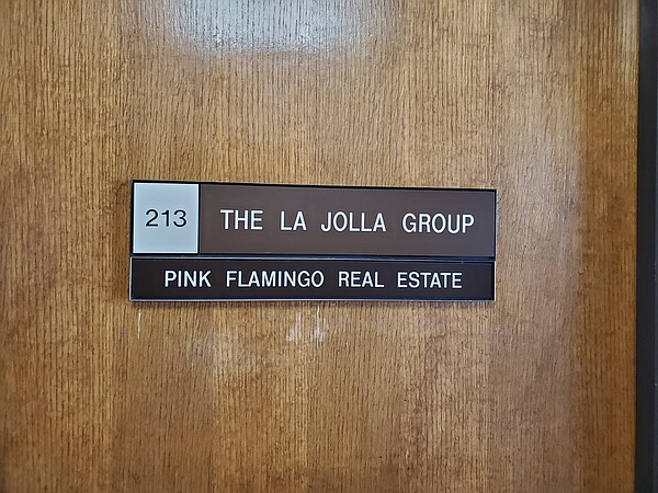 The office door of the La Jolla Group, a petition drive m...