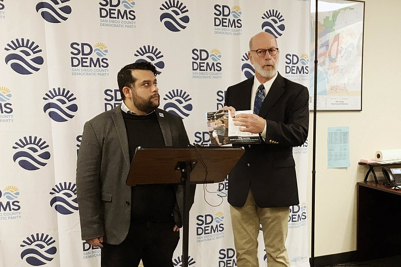 San Diego County Democratic Party Chairman Will Rodriguez-Kennedy (left) with...