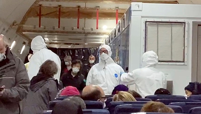 In this image from a video taken on Monday, Feb. 17, 2020, U.S. passengers wh...