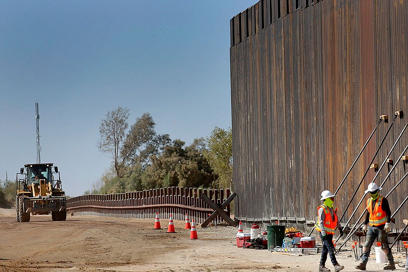 In this Sept. 10, 2019, file photo, government contractors erect a section of...