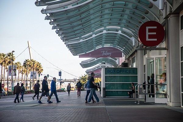 Visitors walk into the San Diego Convention Center on Jan...