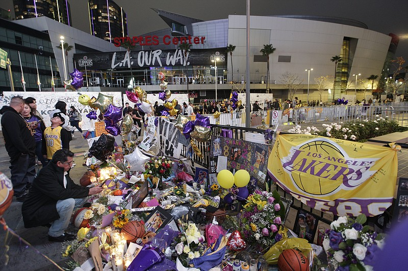 In this Feb. 2, 2020, file photo, fans gather at a memorial for Kobe Bryant i...