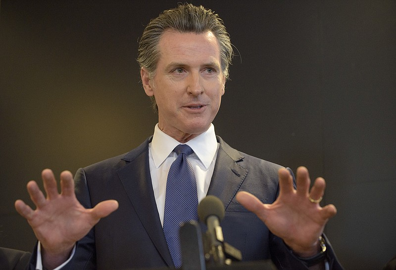 California Governor Gavin Newsom speaks to members of the press at a news con...