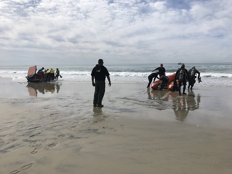 First responders and divers join the search for three people missing form a s...