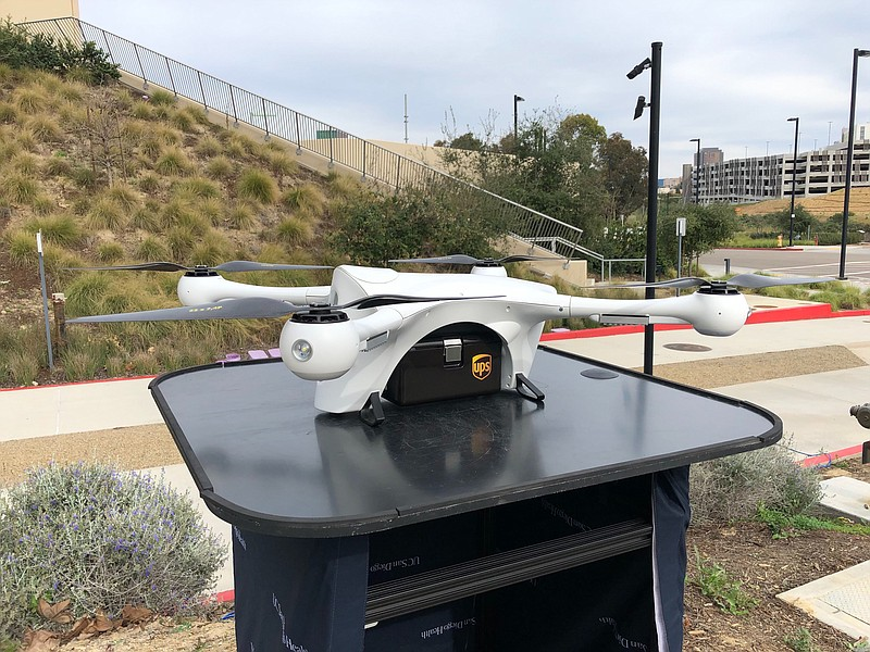 A Matternet company drone holds a UPS package before it takes off in a UC San...