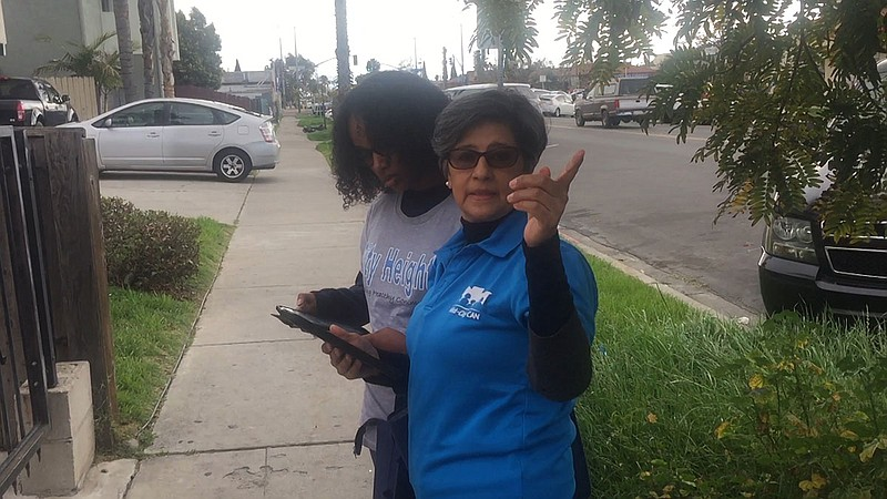 Martha Romero canvasses in City Heights to let her neighbors know about this ...