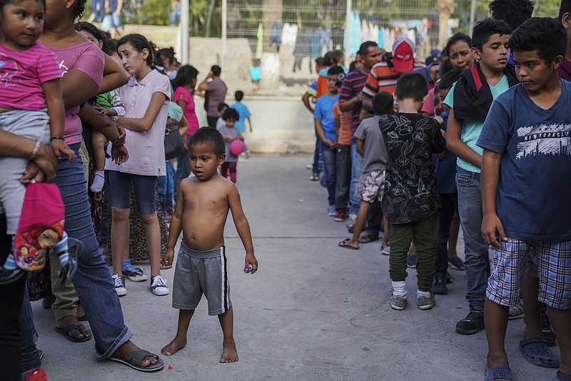 In this Aug. 30, 2019 file photo, migrants, many who were returned to Mexico ...