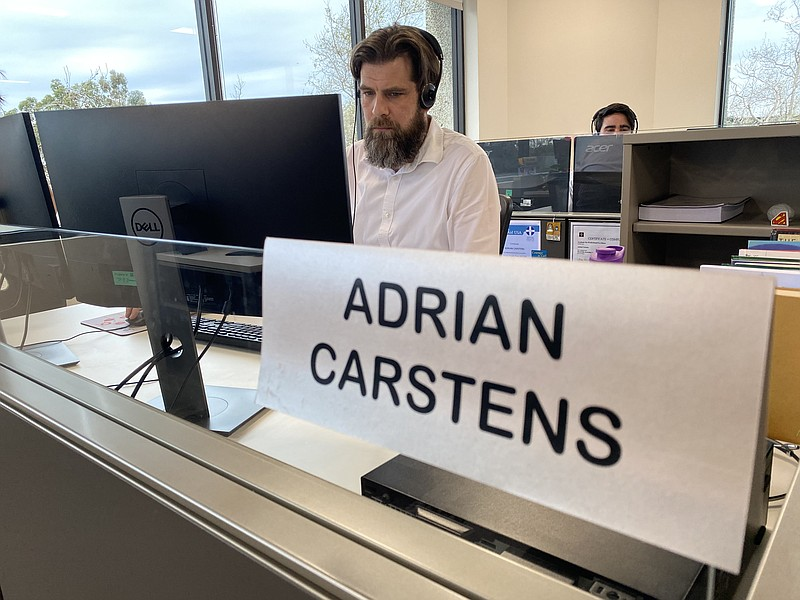 Adrian Carstens, a 2-1-1 San Diego client services supervisor, wears a headse...