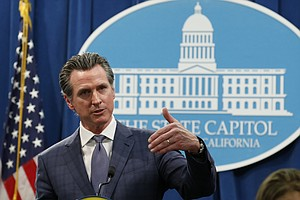 Photo for Newsom's Mask Deal Shows Tendency For Big Plans, Few Details
