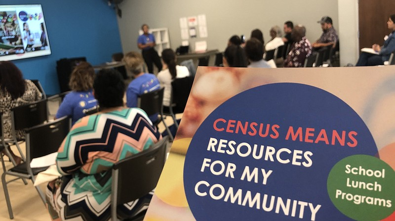 People at the Jackie Robinson Family YMCA on March 6, 2020, hear about the up...