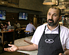 Nael Chami stands inside the restaurant he owns...