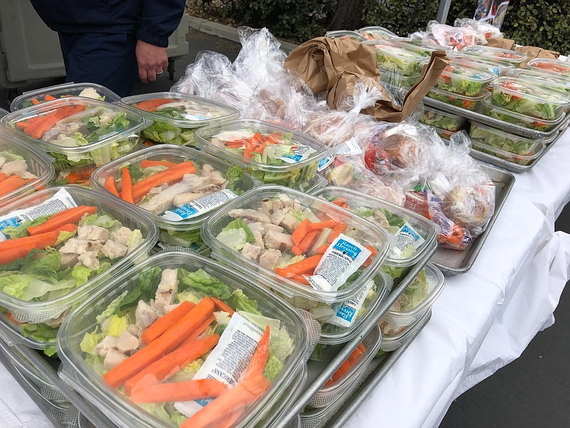 Packaged meals at a San Diego Unified School District distribution site, Marc...