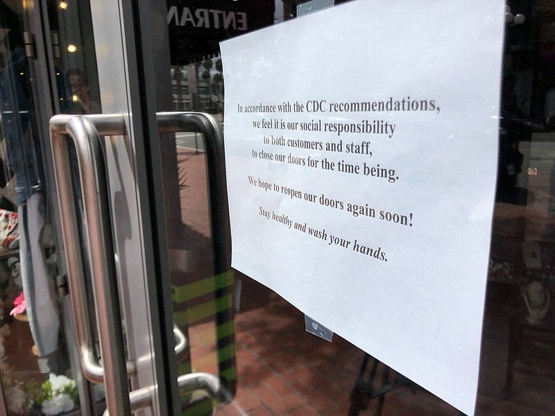 A closed sign at Bubbles Boutique in the Gaslamp Quarters in downtown San Die...