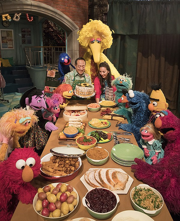 SESAME STREET Season 49 cast at holiday table.