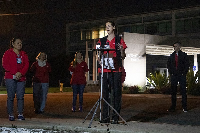 Shannon Cotton, a registered nurse in the Hillcrest ICU, speaks at a news con...