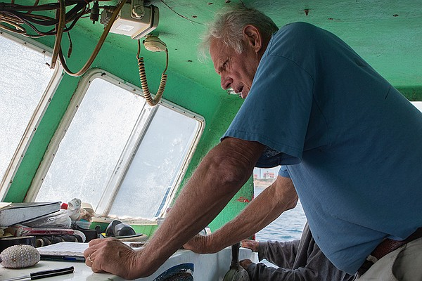 Commercial fisherman Peter Halmay aboard the Erin B., on ...