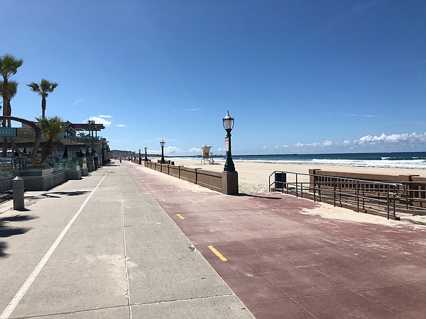 The Mission Beach Boardwalk is completely empty on Tuesda...