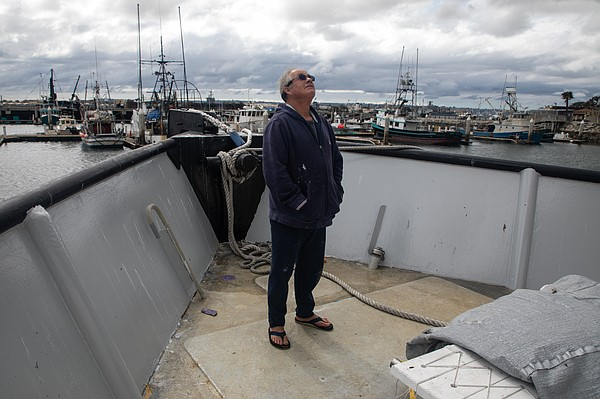 Boat owner Tim Jones surveys ongoing maintenance work fro...