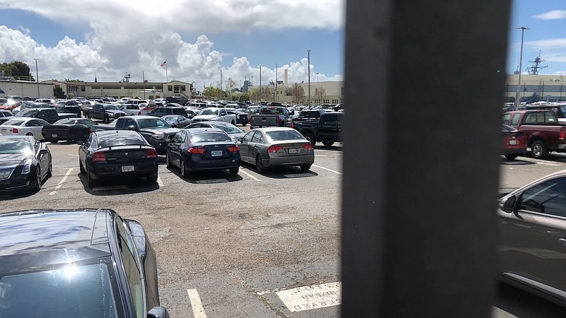 The parking lot at Naval Base San Diego is mostly full despite orders that no...