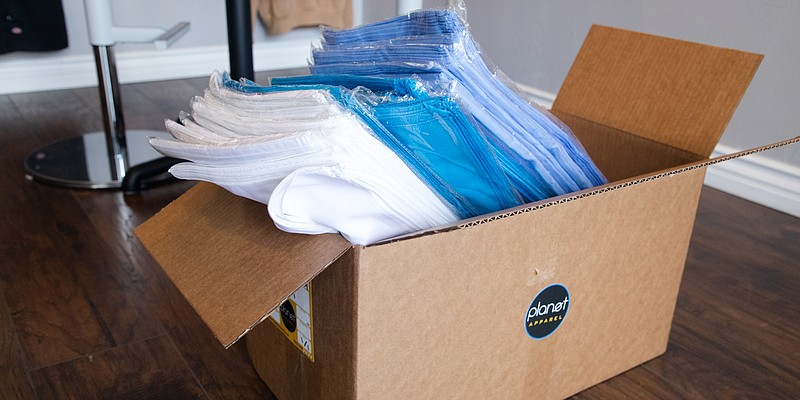 A box of bandanas is shown at the offices of Planet Apparel in San Diego on M...