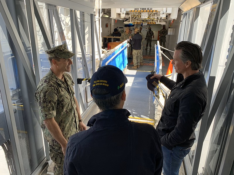 Gov. Gavin Newsom and Rear Adm. John Gimbleton tour the USNS Mercy hospital a...