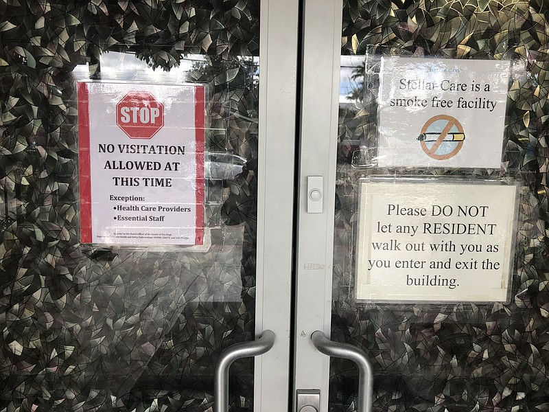 Signs in front of the Stellar Care senior living facility limiting guests dur...