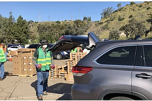 Photo for Emergency Food Drive-Thru Looks To Relieve Pressure From Local Food Distribut...