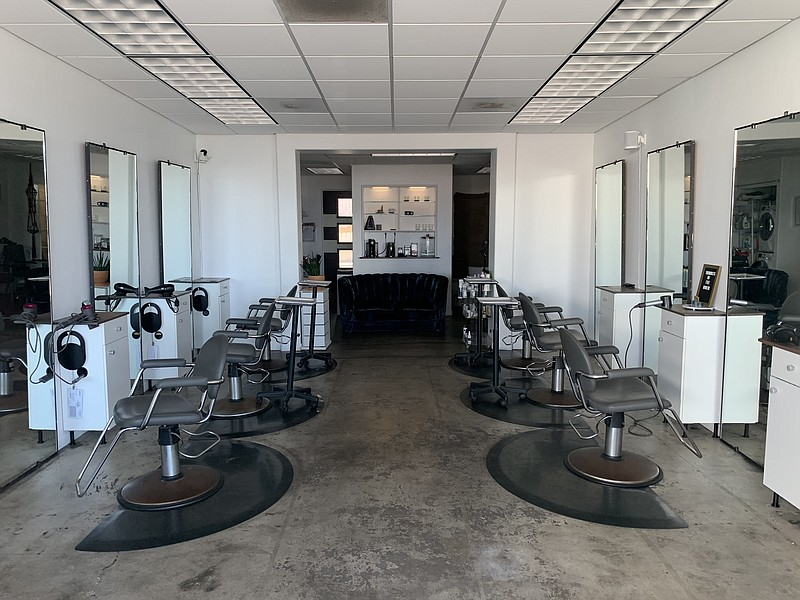 Empty chairs are seen inside Bluxom Salon in North Park, March 30, 2020.