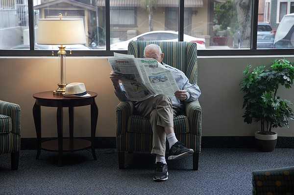Walter Egger reads a newspaper in the common area at St. ...