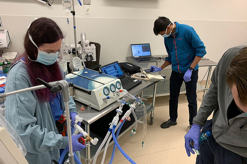 Researchers at the UC San Diego campus test out a ventilator that has been sp...