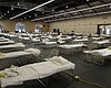 In this April 1, 2020, file photo, cots are set...