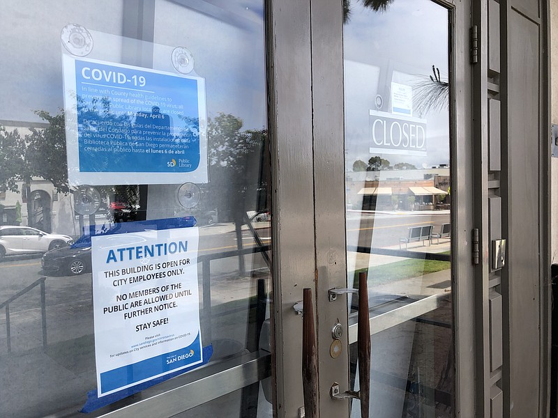 A closed sign at the San Diego Public Library Kensington on April 6, 2020, be...