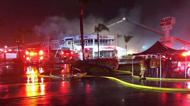 Firefighters fighting a three-alarm fire at the China Max Seafood Restaurant ...