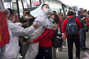 Photo for Masked Crowds Fill Wuhan's Streets, Trains As Lockdown Ends