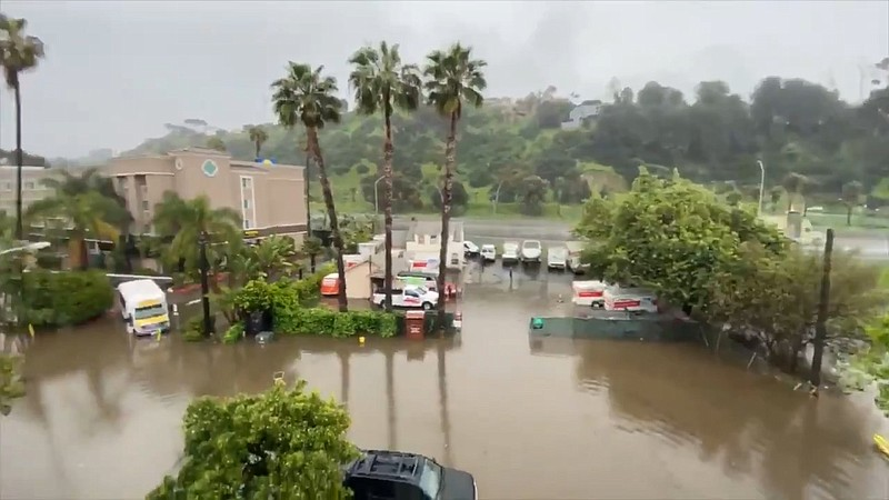 Rain flooded the parking lot at the River Leaf Inn in Mission Valley on April...