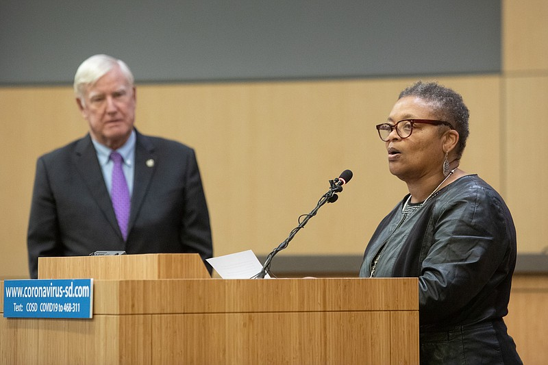 Public Health Officer Dr. Wilma Wooten speaks at a San Diego County news conf...