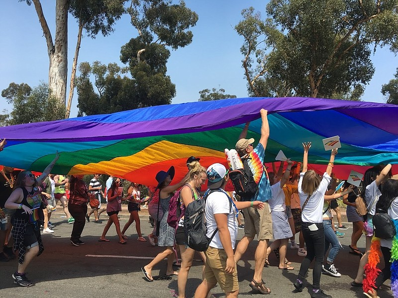 San Diego Pride attendees march during the parade, July 2017.